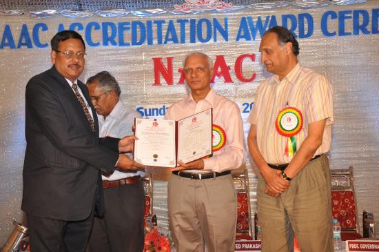 Dr Atul Kumar Singh, Coordinator NAAC, receiving NAAC Accreditation Certificate from Prof Ved Prakash, Chairman UGC